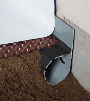 Closeup of a crawl space drainage system installed in Framingham