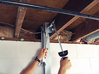 Straightening a foundation wall with the PowerBrace™ i-beam system in a Malden home.