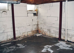 A failed, rusty i-beam foundation wall system installed in Framingham.