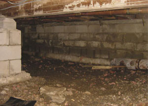 Rotting, decaying crawl space wood damaged over time in Watertown