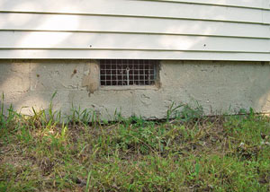 Open crawl space vents that let rodents, termites, and other pests in a home in Medford