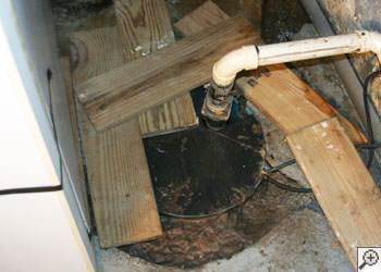 An ugly, clogged sump pump system in Somerville, Massachusetts & New Hampshire