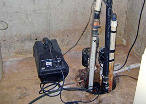 Pedestal sump pump system installed in a home in Methuen