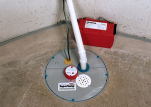A sump pump system with a battery backup system installed in Marlborough