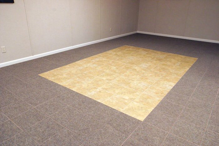 tiled and carpeted basement flooring installed in a Cambridge home