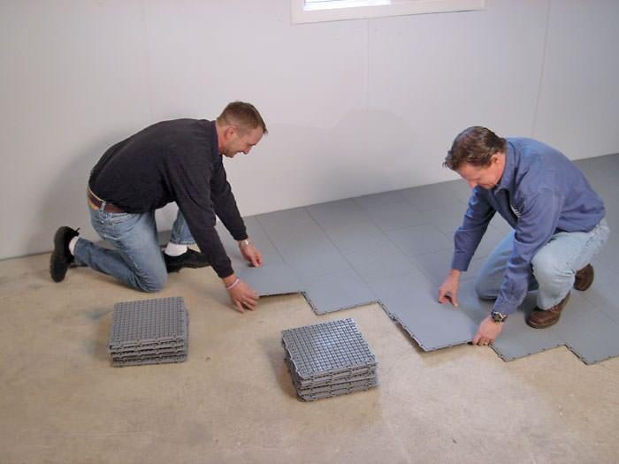 Contractors Installing Bat Subfloor Tileatting On A Concrete Floor In Nashua Machusetts