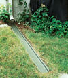 A recessed gutter drain extension installed in Andover, Massachusetts & New Hampshire